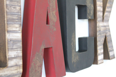 Rustic letters for animal themed nursery letters in brown, red, and black.