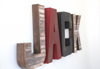 Woodland bear nursery letters in browns, red, and black spelling out Jack.