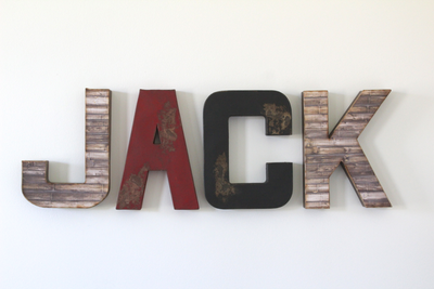 Jack nursery letters in brown, red, and black.