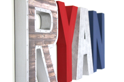 Superman wall name letters in silver, red, and blue.