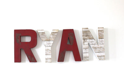 Boys room nursery wall letters in red and white different styles and textures.