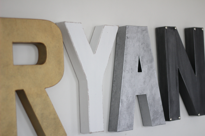 Modern letters for boys airplane nursery decor spelling out Ryan.