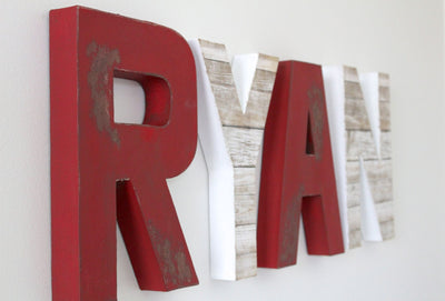 Fireman nursery letters in red and white letters spelling out Ryan.
