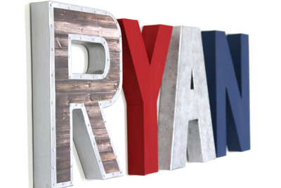 Superhero nursery letters spelling out Ryan for baby nursery decor.