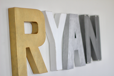 Airplane nursery letters spelling out Ryan.