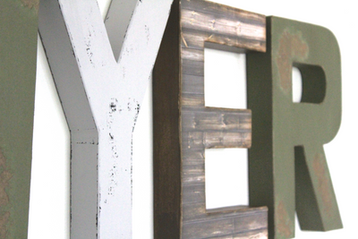 "Gray, green, and brown ""wooden"" nursery wall letters for the letters YER."