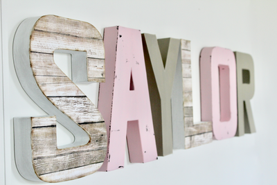 Pink and gray nursery name letters for girls room.