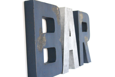 Bar wall letters in navy and silver.
