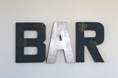 "Rustic bar wall letters in navy distressed ""wooden"" letters and silver ""metal"" letters."