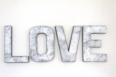 "Love wall sign in a silver ""metal""."