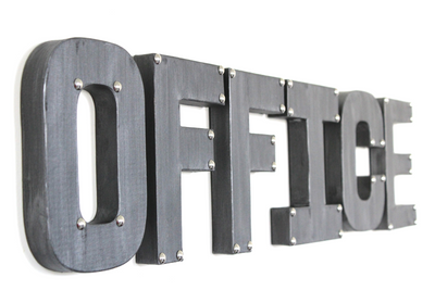 "Silver ""metal"" office wall sign with metal rivets on the corners."