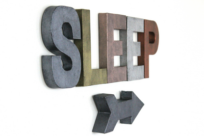 "Industrial ""metal"" sleep sign with arrow in different colors."