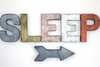"Copper, silver, galvanized, brass, rose gold ""metal letters spelling out sleep with an arrow."