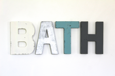 Bath wall sign in different colors and textures.