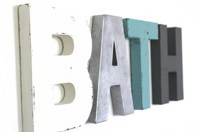 Bath letters in different colors and textures for bathroom wall decor.