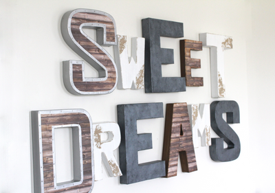 Sweet dreams wall sign for newborn nursery wall decor in different shades and styles and textures.