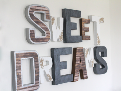 Sweet dreams wall sign for nursery wall decor done in an industrial farmhouse style in gray, white, and brown.