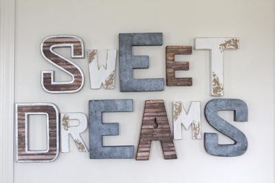 Adorable nursery wall sign saying Sweet Dreams in different colors and sizes.