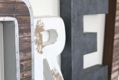 Distressed white letters and gray letter E.