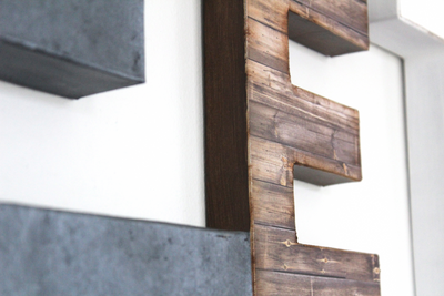 Brown reclaimed wood look letter E and a gray metal look letter E.