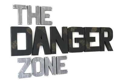 Masculine man cave wall decorative letters spelling out The Danger Zone.