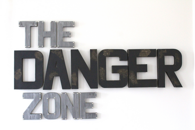 The Danger Zone Sign for man cave wall decor in black and silver letters.