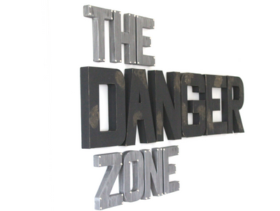 "Black ""wooden"" rustic letters spelling out the word Danger and silver ""metal"" letters spelling out The Zone."