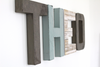 Boys room name letters in gray and blue spelling out THEO.
