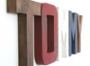 Rustic wall letters spelling out the name TOMMY for boys nursery in brown, red, white, and blue.