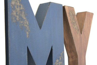 Distressed blue and brown name letters.