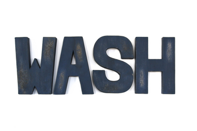 WASH bathroom sign letters in blue