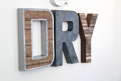 "Wash and Dry Laundry Room Sign in ""wooden"" and ""metal"" letters."