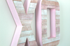 Pink faux reclaimed wooden XO letters.