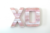 Freestanding pink XO letters.