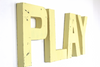"Yellow ""wooden"" play letters for playroom wall decor."