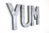 "YUM letters for kitchen wall decor in a silver ""metal"" finish."