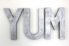 "Large YUM ""metal"" letters."