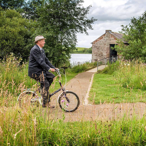 Paul Leith artist on a bike Talkin Tarn Carlisle Cumbria