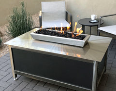 A rectangular stainless steel IMPACT Fire Table with Silver Vein powder coated side panels