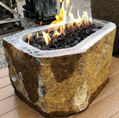 A natural andesite basalt real stone outdoor gas fire pit from Impact Imports in Boise, Idaho.