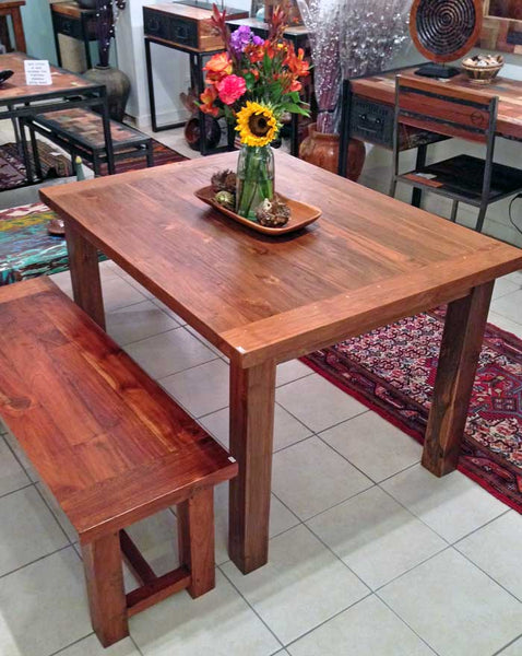 A four 4 foot long x 3 three foot wide dining table with a solid one and five eighths thick table top and 3 inch by 3 inch thick legs made from reclaimed old growth teak