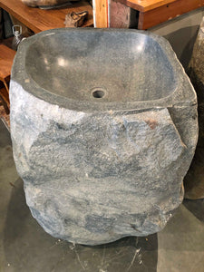 Front view of an Andesite Stone Pedestal Sink hand cut from a single piece of basalt stone with a polished bowl and lip and naturally organic exterior gray or grey in color.