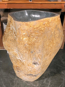 Andesite Stone Pedestal Sink hand cut from a single piece of basalt stone with a polished bowl and lip and naturally organic exterior.