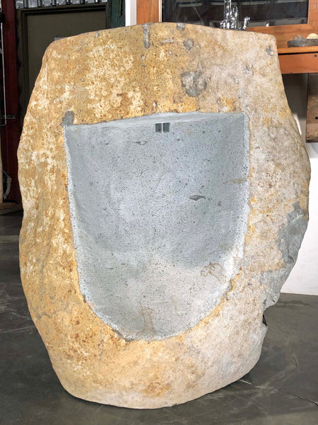 Rear View of an Andesite Stone Pedestal Sink hand cut from a single piece of basalt stone with a polished bowl and lip and naturally organic exterior.