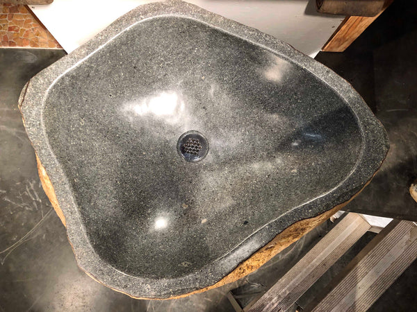 Top view of an Andesite Stone Pedestal Sink hand cut from a single piece of basalt stone with a polished bowl and lip and naturally organic exterior.