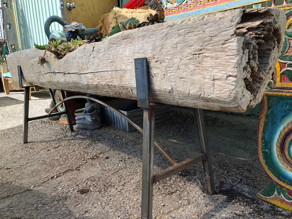 Antique Indonesian old growth teak rice paste making trough converted into a planter box on a custom steel base- Impact Imports