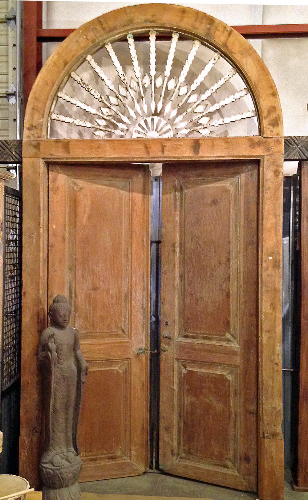 Extra large one of a kind reclaimed salvaged teak door with an arched top and steel arrow details with original hardware from Madura island in Indonesia