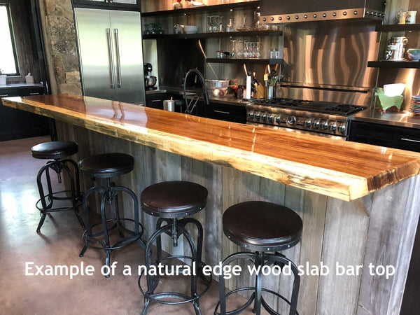 Picture of a natural live edge wood slab bar top with a satin urethane finish installed in a home in Ketchum Idaho