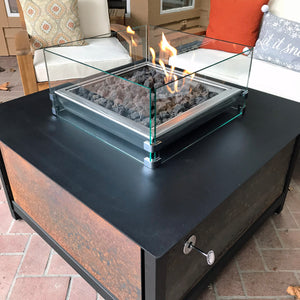A 1/4 in thick square shaped clear tempered glass wind guard screen for a modern industrial style heavy duty steel or stainless steel IMPACT fire table to help reduce wind effects on the flame when the fire table is burning.  Made in the USA America