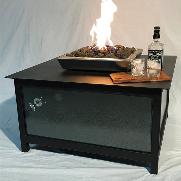 An edgy, urban, contemporary, modern industrial rustic farmhouse style, heavy duty steel Square shaped IMPACT propane or natural gas burning Fire Table or fire pit with silver vein powder coated steel exterior side panels and a raven black powder coated frame and table top for entertaining or relaxing outdoors on your patio, rooftop deck or in your garden.  Made in America USA.